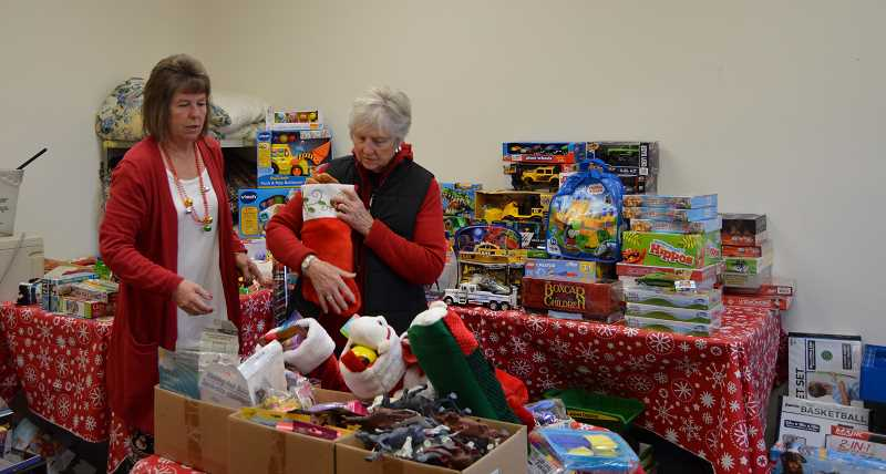 CINDY FAMA - Pictured are Deb Holm and Donna Fix in the Christmas room filled with toys from the KPTV toy drive and donations from members of Clarkes Methodist Church.