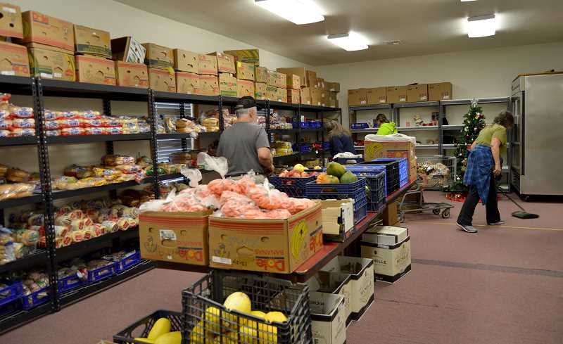 CINDY FAMA - Volunteers get the Colton Helping Hands Food Pantry ready to open.
