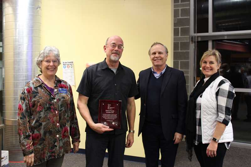 KRISTEN WOHLERS - David Purdy receives the CARE Award at the December school board meeting. From left to right are Marilyn Wood of Kiwanis, Purdy, Superintendent Trip Goodall and Brenda Griffin of Kiwanis.