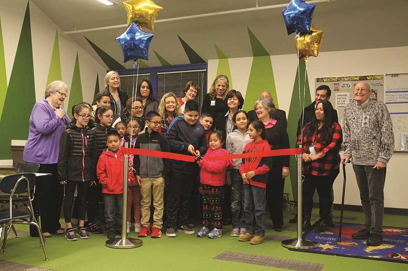 PHIL HAWKINS - Students, faculty, school board members and administrators cut the ribbon on the official opening of Washington Elementary School after more than a year of construction to renovate and remodel the campus.