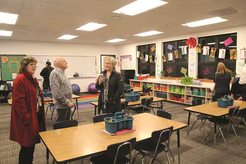 PHIL HAWKINS - Washington Elementary School teacher Annika Figueroa (middle) shows off her classroom on the first floor of the school's new two-story addition, which is built to accomodate an additional 650 students.