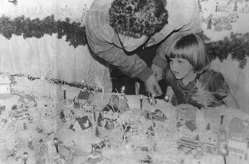 CENTRAL OREGONIAN FILE PHOTO  - Dec. 23, 1993: Tom Travenia and his daughter, Kimberely, take in the Grimes Christmas Scene last night.