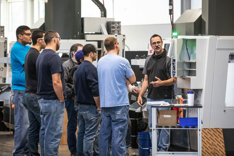 PAMPLIN MEDIA GROUP FILE PHOTO - Instructor Wes Locke gives a lesson on machining in the new Industrial Technology Center building at Clackamas Community College.