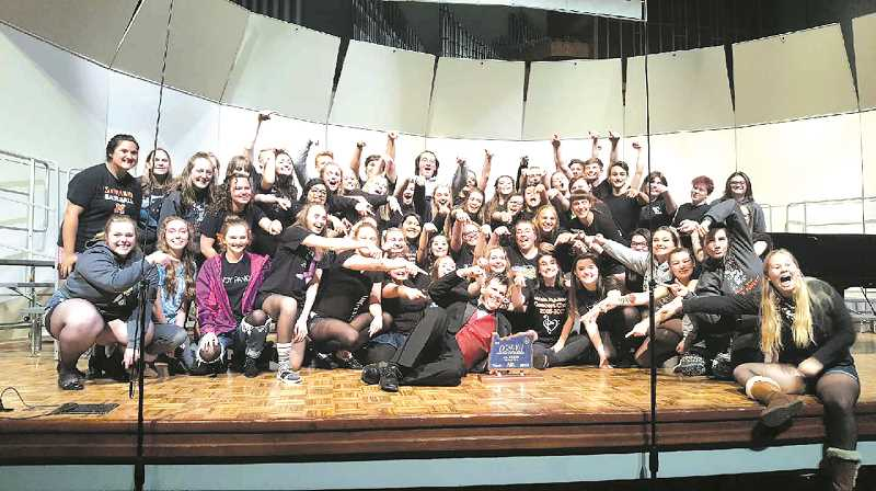Molalla High School's concert choir comes away from the state competition on May 4 with a first place trophy.