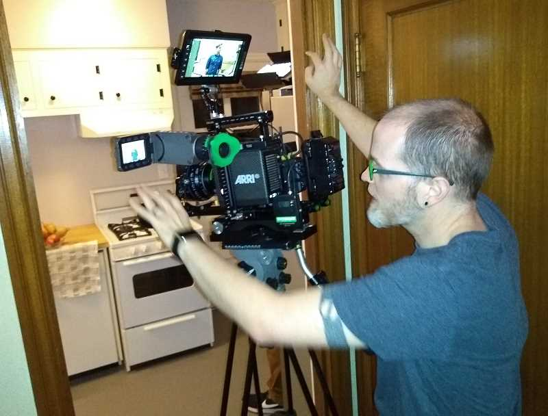SUBMITTED PHOTO: JAN CASTLE - Jeremiah Scott, the director of photography for 'London Connection,' frames a scene in the West Hills bungalow where the short film was shot in early December.