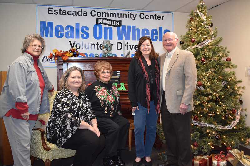 ESTACADA NEWS PHOTO: EMILY LINDSTRAND - Board members and staff at the Estacada Community Center met with Peace Lutheran Church Council President Gary Mauch, who presented them with a $1,000 check from the church.