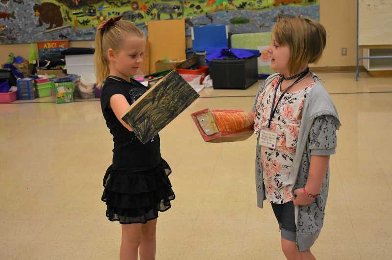 FILE PHOTO - Students at the Estacada School District's Summer Academy play with puppets in theater class. The new program ran for two weeks in August.