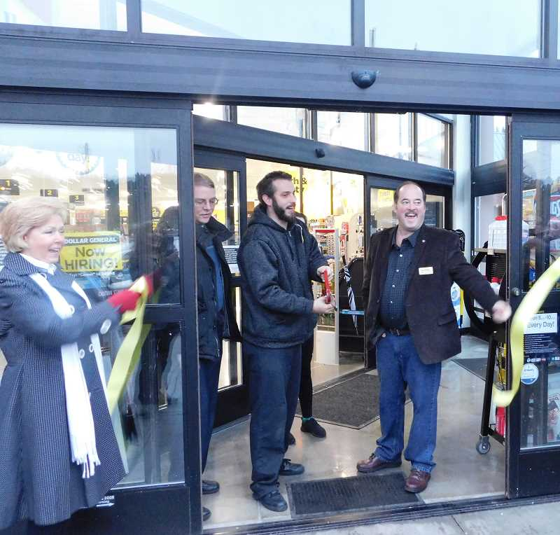 FILE PHOTO - Mayor Sean Drinkwine cuts the ribbon during Dollar General's grand opening in January.