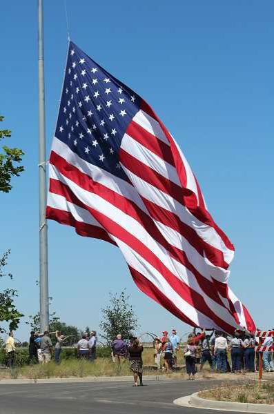 FILE PHOTO - A US flag is lowered.