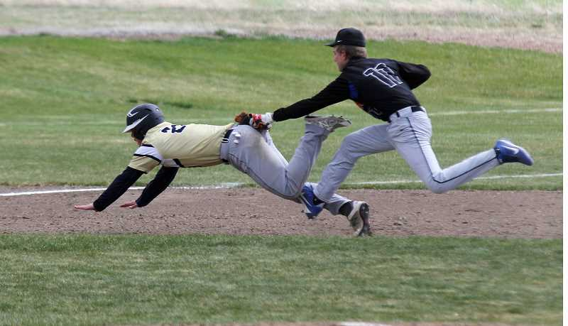 STEELE HAUGEN - Tadd Anderson tags a La Pine runner. Culver baseball made the state playoffs for the first time since 2001.