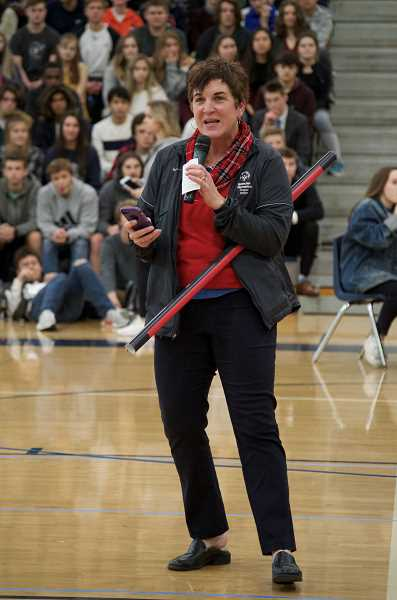 SPOKESMAN PHOTO: CLARA HOWELL  - Jean Hansen, vice president of School Partnerships and Youth Outreach with Special Olympics Oregon, gives a speech during WHS's unified banner unveiling.