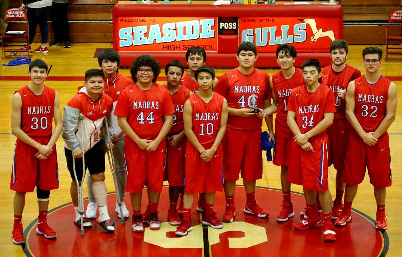 EDWARD HEATH - The White Buffalo boys basketball team poses with their trophy after placing fourth at a Seaside tourney.