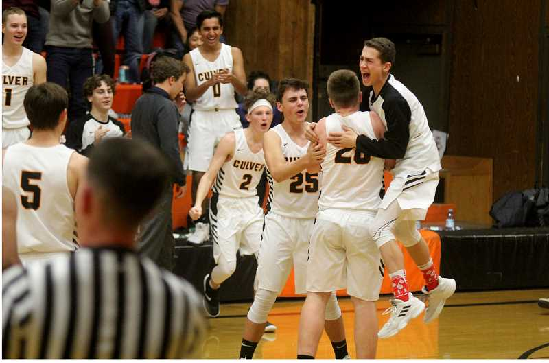 STEELE HAUGEN - The Culver basketball team celebrates after Kyler Cox hits a 3-pointer at the buzzer, right before halftime.