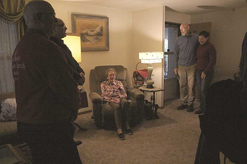 LINDSAY KEEFER - Dawn Moehnke, who turned 100 on Monday, welcomes carolers from Hoodview Church of God into her living room last week.