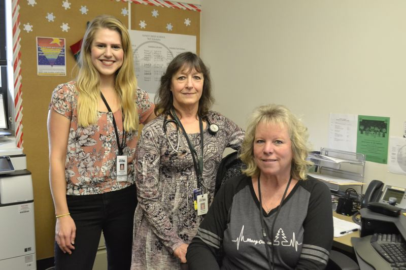 POST PHOTO: BRITTANY ALLEN - Nurse practitioner Kim Tinker (pictured middle) has worked at the Sandy School-Based Health Center since its inception in 2012.