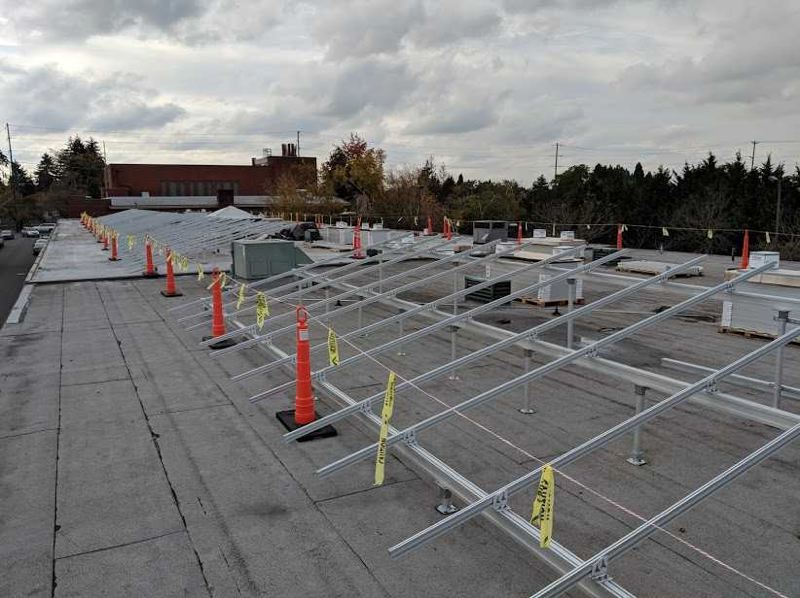 COURTESY OF VERDE - Brackets are installed on the rooftop of St. Charles of Borromeo Church on NE 42nd Avenue to prepare for solar panels. Verde also plans to install a solar array on a community center at the Oak Leaf Mobile Home Park in the Cully neighborhood.