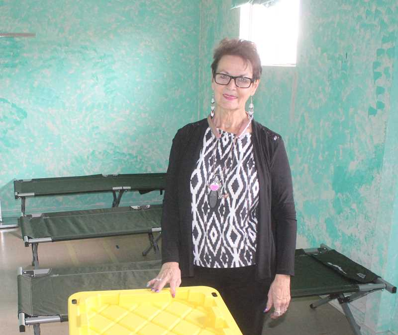SUSAN MATHENY/MADRAS PIONEER - Pat Abernathy sets up one of the sleeping rooms at the warming shelter.