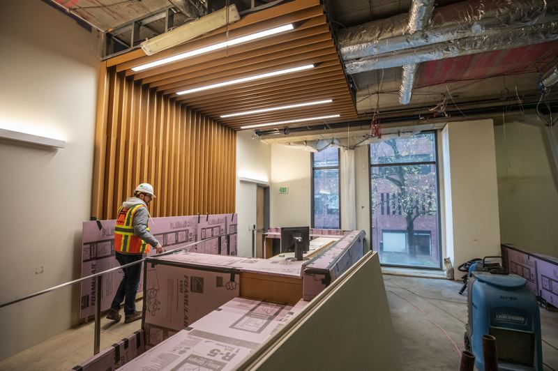 TRIBUNE PHOTO: JONATHAN HOUSE - Hoffman Construction project maanger Justin Paterson walks through what will be a high-traffic courtroom currently under construction at the new Multnomah County Central Courthouse.