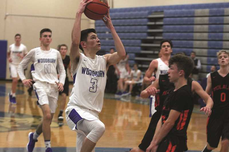 PHIL HAWKINS - Woodburn senior Kevin Cruz and the No. 6 Bulldogs picked up their second victory over the Molalla Indians in the past three games, winning by a margin of 84-34 for their sixth consecutive victory to start the season.