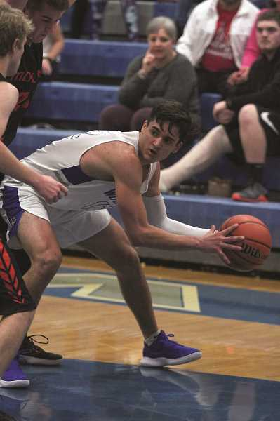 PHIL HAWKINS - Woodburn senior R.J. Veliz scored a game-high 24 points in the Bulldogs' victory over the Molalla Indians.