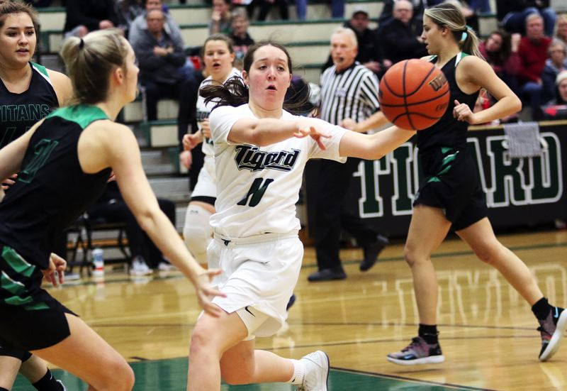TIMES PHOTO: DAN BROOD - Tigard High School senior guard Paige LaFountain (11) passes the ball off on a drive during Fridays game. The Tigers got a 64-57 victory over West Salem.