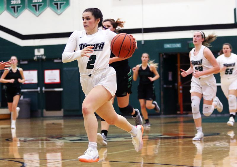 TIMES PHOTO: DAN BROOD - Junior guard Kennedy Brown leads a Tigard fast break during Fridays game. Brown scored 16 points in the Tigers 64-57 win over West Salem.