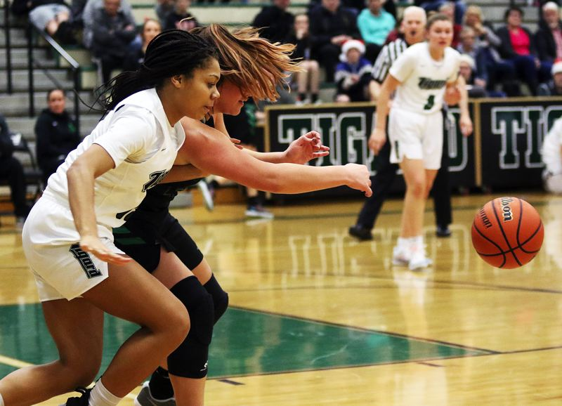 TIMES PHOTO: DAN BROOD - Tigard sophomore Ajae Kadel goes after a loose ball during Friday's game with West Salem.