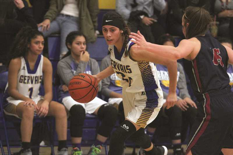 PHIL HAWKINS - Gervais junior Isabel Vasquez had four points and seven rebounds in the Cougars' 62-35 loss to Kennedy on Dec. 19.