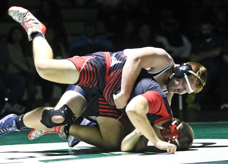TIMES PHOTO: DAN BROOD - Tigard High School senior Carter Dennis is in control of his 220-pound match with Oregon Citys Henry Schoenfeld. Dennis won by fall in a time of 4:34.