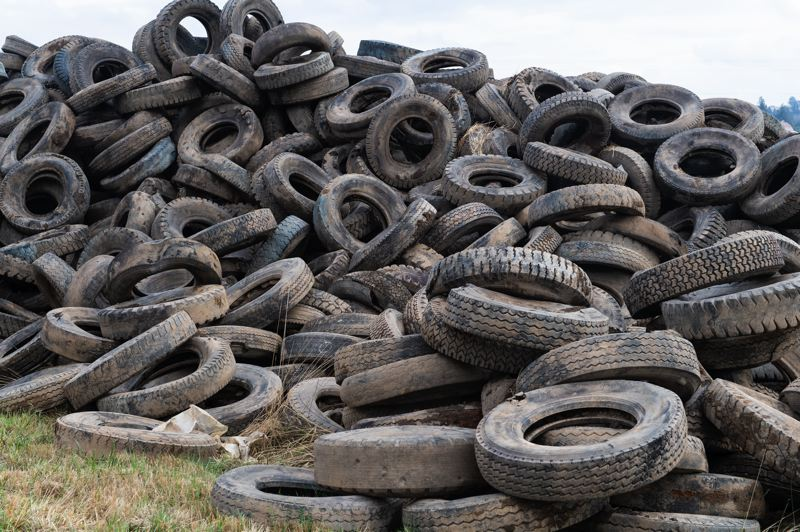STAFF PHOTO: CHRISTOPHER OERTELL - Large truck tires sit in piles off of Spring Hill Road near Gaston in October, removed during a joint Metro and Clean Water Services project to restore wetland habitat.