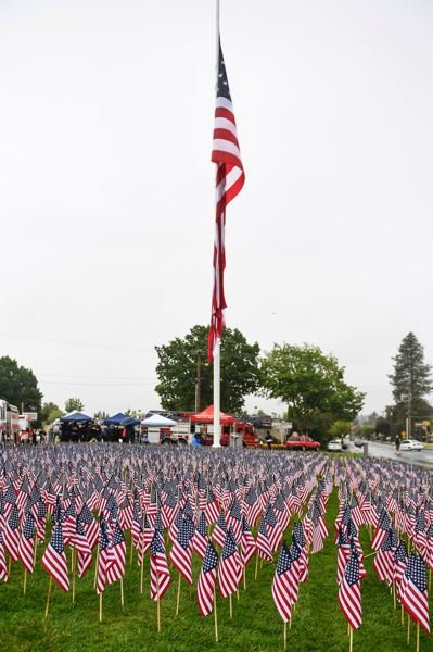 STAFF PHOTO: CHRISTOPHER OERTELL - Three thousand miniature U.S. flags were placed around the big flag in Forest Grove for the Sept. 11 memorial ceremony.
