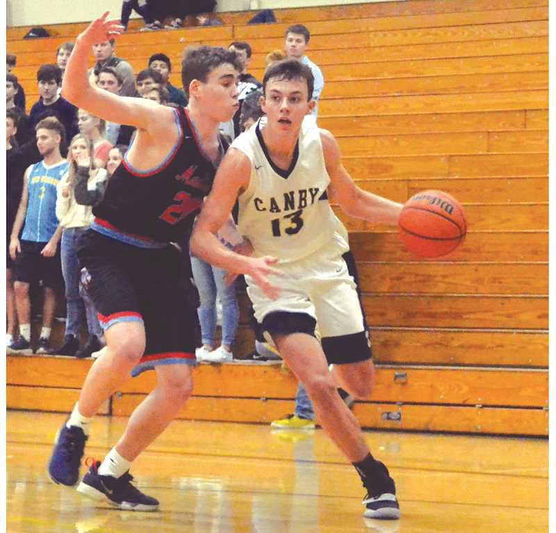 HERALD PHOTO: TANNER RUSS - Sophomore Ben Bailey led the team in scoring against Madison.