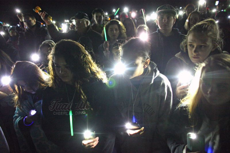 TIMES PHOTO: JAIME VALDEZ - Students in February 2018 light up the Tualatin High School football field with their phones in rememberance of lives lost, during a candlelight vigil following the shooting in Parkland, Fla.