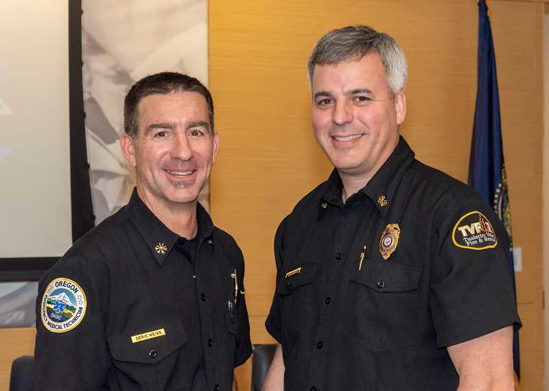SUBMITTED PHOTO - New TVFR Chief Weiss (left) with outgoing Chief Duyck.