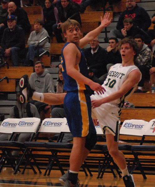 OUTLOOK PHOTO: DAVID BALL - Jesuit's Matthew Levis watches a 3-point try spin toward the hoop after a close out by Barlow's Noah Lowery. Levis scored a team-high 16 points.
