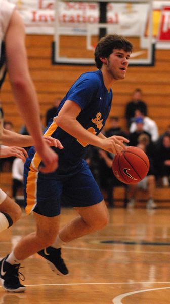 OUTLOOK PHOTO: DAVID BALL - Barlows Jared Vedus looks to make a move into the lane.