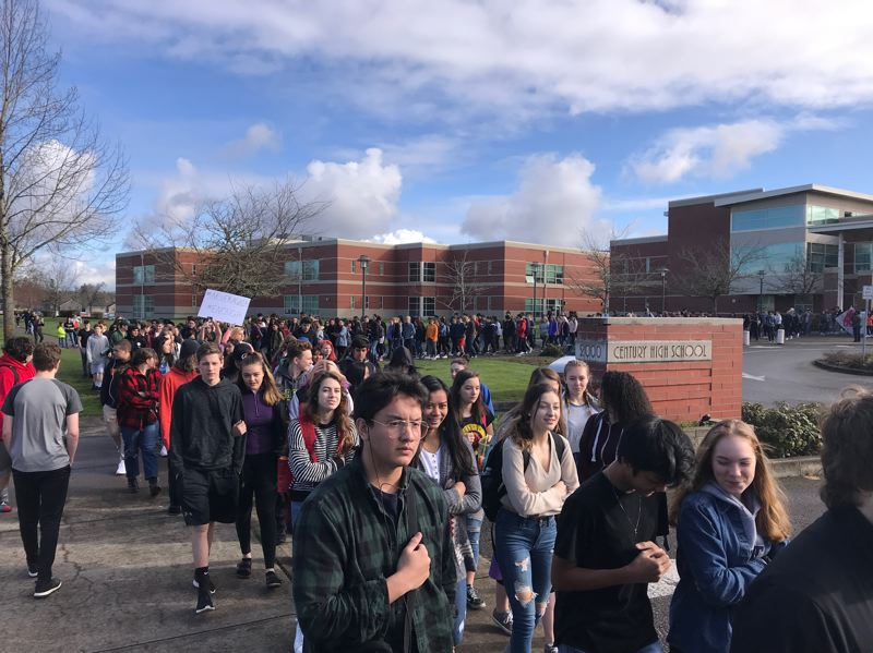 STAFF PHOTO: GEOFF PURSINGER - Students at Century High School walk out on March 14 to protest gun violence in schools.