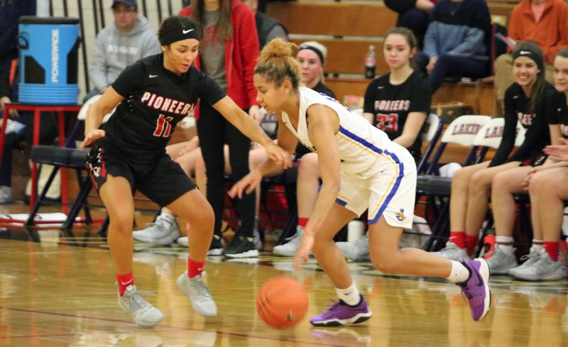 PAMPLIN MEDIA: JIM BESEDA - Oregon City's Tyra Bradford (11) puts defensive pressure on Jefferson's Fara Kelly during the first half of Wednesday's opening game of the Nike Interstate Shootout at Lake Oswego High School.