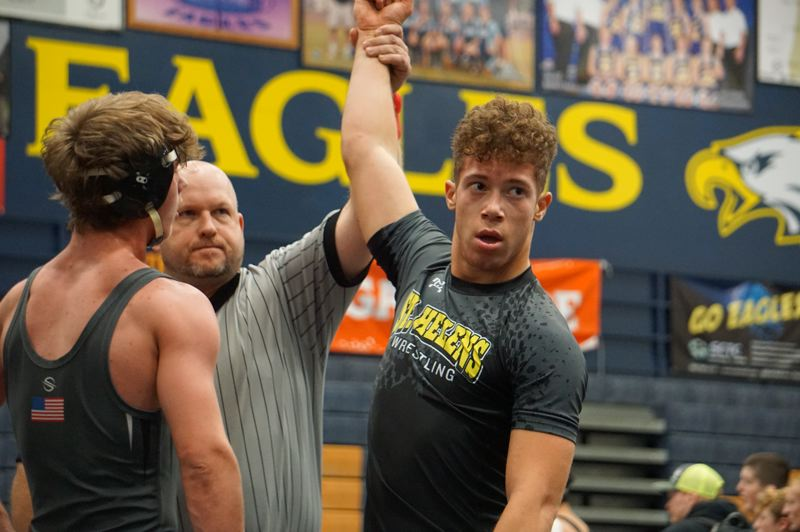 PHOTO COURTESY: AMY GADBOIS - Shawn Lee of St. Helens celebrates a recent wrestling victory against Reynolds.