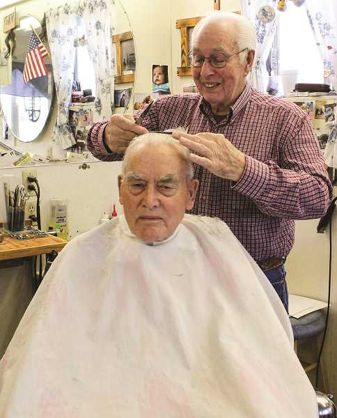 HOLLY SCHOLZ/CENTRAL OREGONIAN   - Harry Vaughan, of Prineville, was one of Monte Gibson's first customers when he opened his barber shop in Prineville 34 years ago.