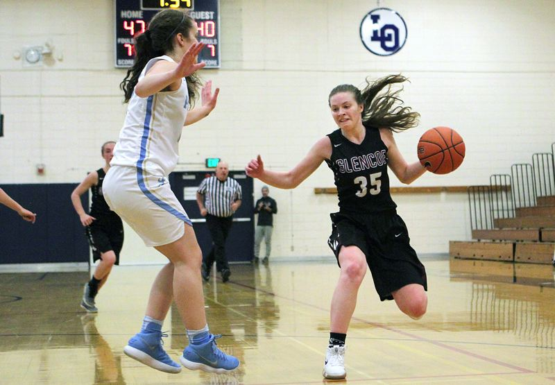 PAMPLIN MEDIA GROUP PHOTO: MILES VANCE - Glencoe's Mallory Confer makes a move during her team's 52-49 loss to Lakeridge in the first round of the Nike Interstate Shootout at Lake Oswego High School on Dec. 26.