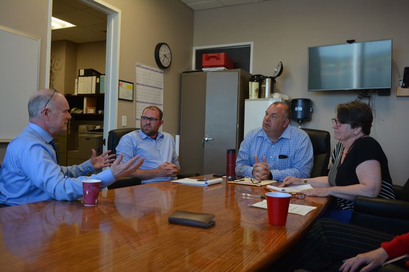 SPOTLIGHT FILE PHOTO - Former Sheriff Jeff Dickerson, left, discusses options for finding a new sheriff with Columbia County commissioners last spring. Dickerson retired from his elected position as sheriff in 2018. His exit was one of several staffing shake-ups at the agency.