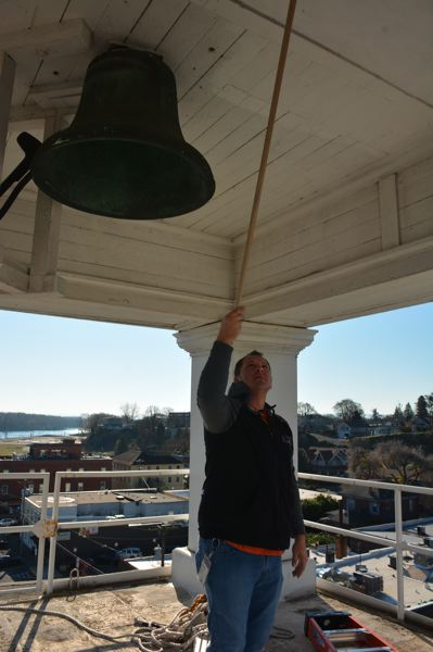 SPOTLIGHT PHOTO: COURTNEY VAUGHN - Andy Ventris inspects the bell atop the Columbia County Courthouse clock tower. The clock tower requires regular maintenance by county employees and a local historian.