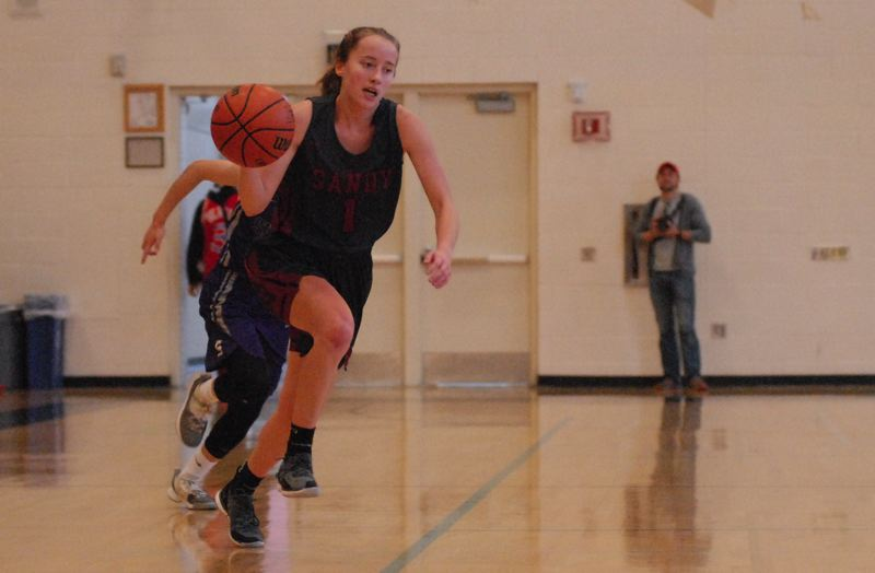 SANDY POST: DAVID BALL - Sandys Isabella Kansala makes a dash to the basket after coming up with a steal in the backcourt during the Pioneers 47-25 loss to Sunset on Thursday.