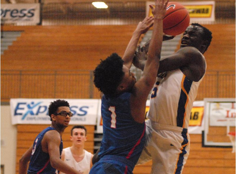 OUTLOOK PHOTO: DAVID BALL - Barlows Charles Ndayizeye looks to send a shot over the top of Churchills Ejim Akuma III during the Bruins 94-85 overtime win Thursday.
