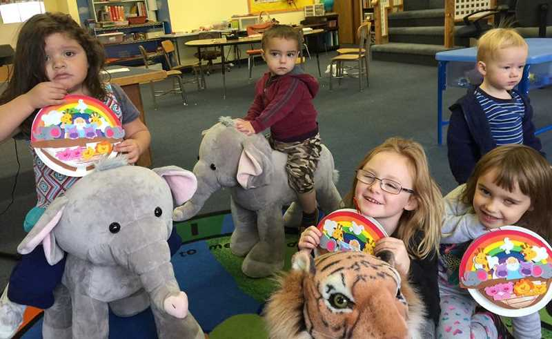 SUBMITTED PHOTO - Kids enjoy a recent story time at Madras Christian School.