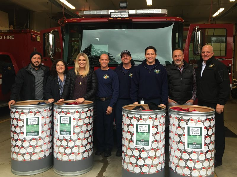 SUBMITTED PHOTOS - Resers Fine Foods staff donate coats and other winter items to the Clackamas Fire drive.