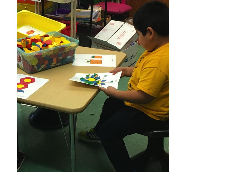 Abraham Reyes-Calva tries a wobble stool in math class at Jennings Lodge Elementary School. The flexible seating option gives children a new perspective on learning.