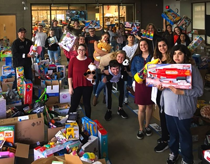 Student leaders at Gladstone High School helped organize the annual Adopt-a-Family holiday project in Gladstone, working to order specific toys for each child and sort a mountain of food donations from the community.