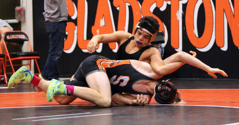 PAMPLIN MEDIA: JIM BESEDA - Putnam senior Jonny Hernandez pinned Scappoose's Trevor Jackson with 58 seconds remaining in the second round of the 152-pound semifinals at the Dec. 21 Gladstone Invitational.